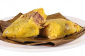 Tamal. Meat bone with chickpeas stuffed in a mashed corn.