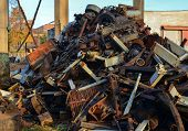 Rusty Engines Stacked In The Scrapyard. Engine Parts Greased And Covered With Rust. Dump Of Pieces O poster