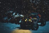 Radio-controlled Car In The Snow At Night, Lights Shine. Christmas Present Rc Car poster