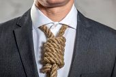 Midsection of businessman with noose used as a tie around is neck whilst wearing suit and shirt, hig poster