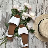 White Sandals On A Wooden Background. Close Up poster