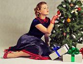 Woman next to Christmas tree
