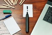 Exclamation Mark Over A Black Pen On Writing Desk
