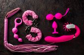 Different Sex Toys Fur Handcuffs, Love Balls, Butt Plug, And Other poster