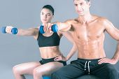 Two smiling people with fitness ball in the gym. Personal fitness instructor. Personal training. Gym poster