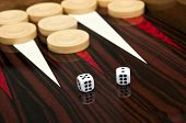 Backgammon table and dice closeup