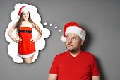 Santa Claus Dreaming Of Sexy Miss Santa In Thought Bubble - Christmas Romance poster
