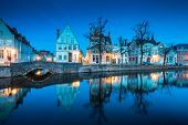 Beautiful Twilight View Of The Historic City Center Of Brugge With Old Houses Along Famous Potterier poster