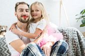 Adorable Little Daughter In Pink Tutu Skirt Hugging Happy Father With Red Lipstick poster