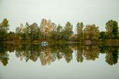 Autumn Landscape. Lake, Trees And Village By The Lake. Calm. Perfect Reflection In The Water. Boat W poster