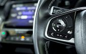 Transportation Vehicle And Car Cruise Control Concept - Close Up Car Cruise Control On Car Steering  poster