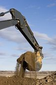 Excavator Arm And Scoop Digging Dirt At Road Construction