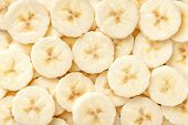 Background Of Ripe Sliced Banana Slices, Closeup. Food Backdrop From Fruit. poster