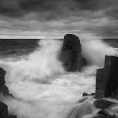 Dramatic Nature Background - Big Waves And Dark Rock In Stormy Sea, Stormy Weather. Dramatic Scene.  poster