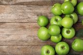 Many Juicy Green Apples And Space For Text On Wooden Background, Top View poster