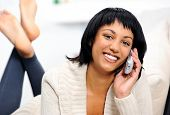 Cheerful woman conducting telesales while working from home