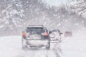 Winter, Snow, Blizzard, Poor Visibility On The Road. Car During A Blizzard On The Road With The Head poster
