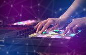 Hand remixing music on midi controller with colorful connectivity concept poster