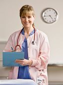 Nurse with stethoscope and medical chart in doctor?s office
