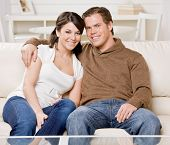 Happy couple relaxing on sofa in livingroom