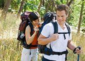 Woman opening boyfriends backpack