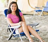 Woman sitting in chair at campsite