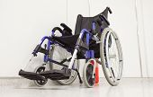 Wheel chair in hospital corridor