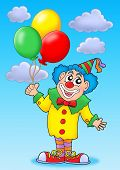 Clown With Balloons On Blue Sky