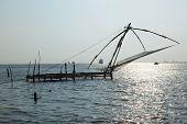 Kochi chineese fishnets on sunset. Fort Kochin, Kerala, India