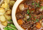 Beef bourguignon stew with fork-crushed new potatoes and asparagus.