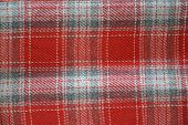 picture of kilts  - Scottish kilt fabric close-up background: detail of the Scottish Kilt-like skirt, red, white, gray and and silver color threads