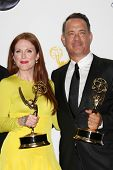 LOS ANGELES - SEP 23:  Julianne Moore, Tom Hanks in the press room of the 2012 Emmy Awards at Nokia