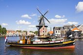 Windmill And Boat, Haarlem, The Netherlands
