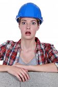 A wide-eyed tradeswoman