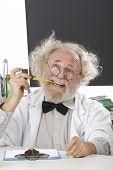 Eccentic Scientist In Lab Thinks Of Ideas