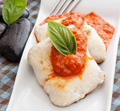 stock photo of hake  - hake fillet with pepper sauce on white tray - JPG