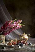 image of gladiola  - Vertical image of fruit and gladiola flowers with old fashioned tea set - JPG
