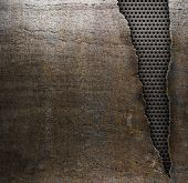 grunge metal background with ripped hole