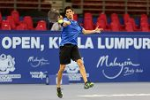 KUALA LUMPUR - SEP 22: Michael Yani of USA plays in the qualifying match of the ATP Tour Malaysian O