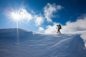 stock photo of snowy hill  - Happy hiker girl In Winter Mountains Snowshoeing - JPG