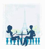 Young Couple Flirt And Drink Champagne In Paris