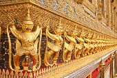 picture of mahabharata  - The statues of Garuda battling naga serpent on the wall of temple in Thailand - JPG
