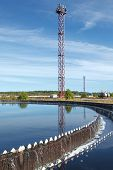 image of reprocess  - Blue sky reflection in sedimentation settler on treatment plant - JPG