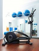 Aerobics cardio training elliptic crosstrainer bicycle device at gym