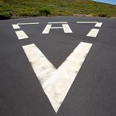 heliport triangle white soil painted sign in pavement