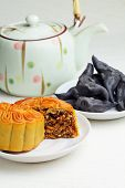 Moon cake with tea and water caltrop
