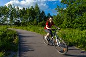 Girl biking on cycle lane