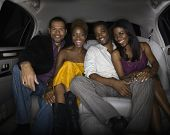 Young friends in back of limousine