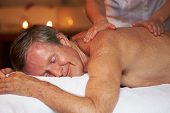 Senior Man Having Massage In Spa