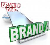 The words Brand A and Brand B on a see-saw scale or balance, weighing the benefits of two brands to